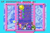 Super Bust-A-Move Game Boy Advance Try to slide the yellow bubble through the obstacle and get the giant yellow bubble