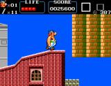 Astérix SEGA Master System Obelix doing some roof-topping.