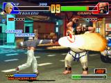 The King of Fighters '98: The Slugfest PlayStation Orochi Yashiro attacks with his SDM Hoeru Daichi and, for an instant, Chang Koehan's guard is crush.