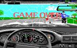 The Duel: Test Drive II DOS Knocking down a cop means instant game over (EGA)