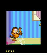 Garfield's Day Out J2ME Introduction: Garfield kicks Odie out.