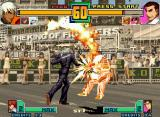 "The King of Fighters 2001 Neo Geo Takuma Sakazaki lost the chance to attack K' : as ""punishment"", is flamed by his Crow Bites move..."