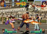 The King of Fighters 2001 Neo Geo Assisted by Mai Shiranui's flaming fans, Goro Daimon tries to attack May Lee, that calls for help...