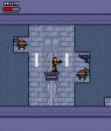 Tomb Raider: Elixir of Life J2ME Gun turrets and robotic sentries guard this lift-shaft.