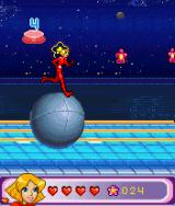 Totally Spies!: The Mobile Game J2ME Clover running on top of a boulder. (large screen)