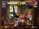 The King of Fighters '95 PlayStation Ralf Jones using one of his attacks (Blitzkrieg Punch) against a crouching-defensive Mai Shiranui.