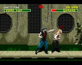 Mortal Kombat II Amiga Baraka takes a punch in the face