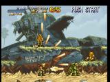 Metal Slug: Super Vehicle - 001 PlayStation Marco Rossi using the Heavy Machine Gun to free some hostages... and to hit-beat some soldiers too!