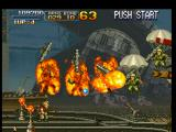 Metal Slug: Super Vehicle - 001 PlayStation Marco Rossi killing a row of parachute soldiers with the acquired Flame Shot: it's a burning strike!