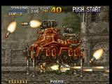 Metal Slug: Super Vehicle - 001 PlayStation While Armored Carrier shoots some rockets against Marco, he strikes back with the Heavy Machine Gun.