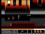 Predator 2 SEGA Master System Bad guys are shooting from the windows. You see a large gun on the floor