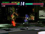 Tekken 2 PlayStation Law gets knocked off his feet.