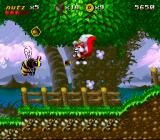 Mr. Nutz SNES Throwing a nut at a bee