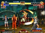 The King of Fighters '96 Neo Geo Aiming to hit-damage a recovering Mature successfully, Andy Bogard executes his Shouryuu Dan move.