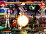 The King of Fighters '97 Neo Geo Kyo Kusanagi performs a kick at the same time that Athena Asamiya executes her Nu Psycho Reflector.