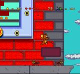 Tom and Jerry SNES Jerry takes the ground rote and, aiming to reach the top, he jumps in direction to a floating brick.