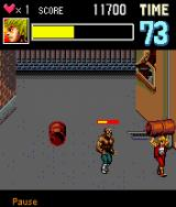 Double Dragon EX J2ME Throw a barrel to get rid of the boss quickly.
