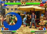 The King of Fighters '98: The Slugfest Neo Geo Clark Steel attempting to hit-damage Leona Heidern during the execution of her Moon Slasher attack.