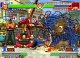 The King of Fighters '98: The Slugfest Neo Geo Billy Kane takes advantage of Shermie's open guard and attacks her through his 5-hit SDM Dai Senpuu.