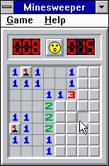 Microsoft Windows 3.1 (included games) Windows 3.x Minesweeper - Suspected mines marked... what will this square reveal?  The happy face is in suspense.