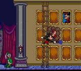 Mickey's Ultimate Challenge SNES Mickey cleans the paintings in a memory game.