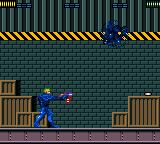 X-Men: Mojo World Game Gear The fourth boss, Fitzroy. He's only vulnerable when shooting his gun.