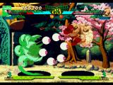Marvel Super Heroes vs. Street Fighter PlayStation Shuma-Gorath executes his projectile-based move Mystic Share during Zangief's kickin' counterattack.