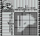 Picross 2 Game Boy Chipping away at the puzzle.