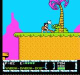The Flintstones: The Surprise at Dinosaur Peak! NES Fred hitting a small dinosaur.
