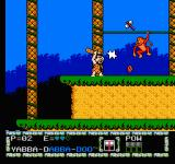 The Flintstones: The Surprise at Dinosaur Peak! NES Hitting the monkey with the throwing axe and evading the coconut by hitting it with the bat.