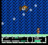 The Flintstones: The Surprise at Dinosaur Peak! NES The big spider boss throwing small webs to Fred.