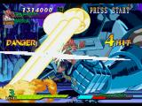 Marvel Super Heroes vs. Street Fighter PlayStation Dhalsim is hit-damaged by Apocalypse's Hyper Combo Ground Zero Eye Beam: it's a dangerous situation!