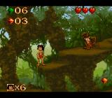 Disney's The Jungle Book SNES The monkeys throw fruit. You can shoot them or land on them.