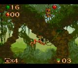 Disney's The Jungle Book SNES Swinging on a vine. The mask above, if you can get it, gives you invulnerability, for a short time.