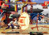 The King of Fighters '97 Neo Geo CD Billy Kane using his jumping attack Kyoushuu Hishou Kon to avoid Yuri Sakazaki's Haou Shoukou Ken...