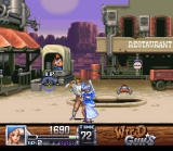 Wild Guns SNES On the streets of Carson City. Annie about to whack a guy in the head that came a little too close