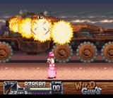 Wild Guns SNES Annie about to be fried by the flame thrower of the Desolation Canyon boss