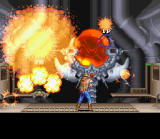 Wild Guns SNES Clint detonates a bomb and gives the Ammunition Depot end boss a new definition of pain
