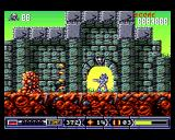 Turrican II: The Final Fight Amiga Firing at a slimy enemy.