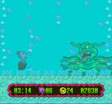 Super Widget SNES He's dropped off a container that has turned into this slime monster
