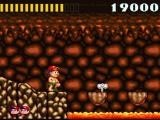 Super Adventure Island SNES Hmm, it looks like jumping over the lava pit...