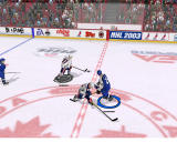NHL 2003 Windows Team USA player blocking team Finland's player.