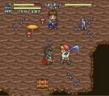 Mahōjin GuruGuru 2 SNES Fighting red robed raging rats.