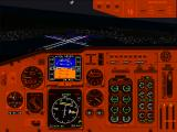 Microsoft Flight Simulator for Windows 95 Windows The Boeing 737 cockpit illuminated at night.