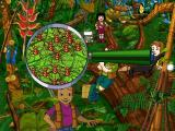 Scholastic's The Magic School Bus Explores the Rainforest Windows Studying red ants with a magnifying glass.
