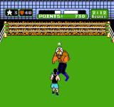 Mike Tyson's Punch-Out!! NES Punching Great Tiger in the stomach and getting a star. You need stars to be able to perform uppercuts.