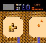 The Legend of Zelda NES Moving a boulder and finding a hidden stairway.