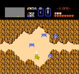 The Legend of Zelda NES Exploring some mountains, trying to kill jumping spiders called tektites.