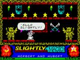 Slightly Magic ZX Spectrum Use the hearing spell to get the two deaf watchmen to let you through.