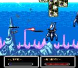 Shockman TurboGrafx-16 Attacking large, squid-like enemies with a charged shot